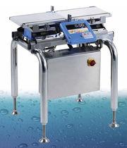 Весовое сортирующее устройство для упаковочной машины