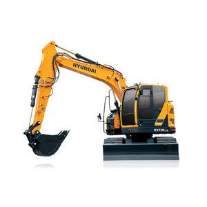 промежуточный экскаватор / гусеничный / дизельный / для строительной площадки