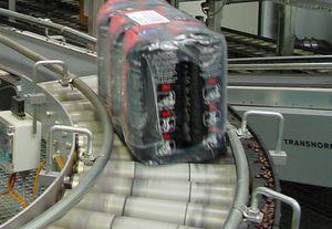 конвейер с механизированными роликами